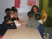 Ms. Toomey enlightening children with a book